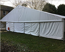 Reception tent for speech venue with flooring